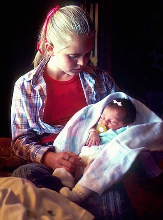 Southern girl holding her baby sister. 100 Southern Baby Names for Boys and Girls.