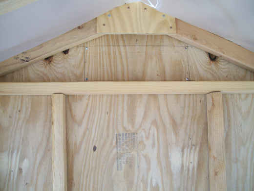 The hole for the rear vent was marked, drilled, and cut after the rear siding was installed.
