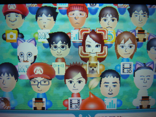 A close-up shot of the Miis gathered in the plaza.