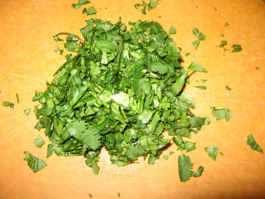 Roughly chop a handful of cilantro.  There is no substitute for fresh cilantro!  It MAKES the salsa!