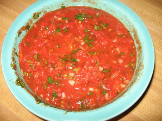 Mix all the ingredients together.  Look: Salsa!