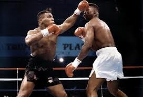 Mike Tyson defended the heavyweight title by beating the fight out of Tyrell Biggs.