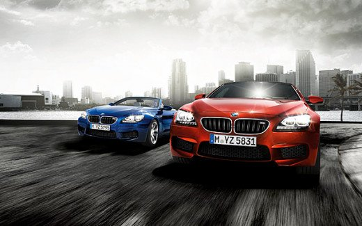 Front view of the BMW M6 Coupe in Sakhir Orange and the BMW M6 Convertible in Estroil Blue