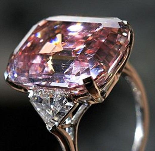 A close caption of a Pink Diamond Engagement Ring