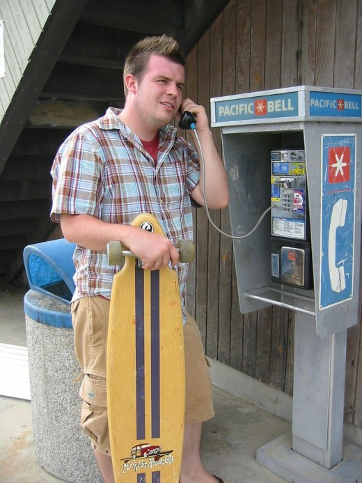 Get your cell activated already or risk having to find a payphone like this sad, sad man.
