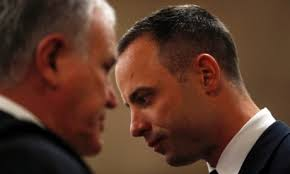 Oscar Pistorius in court talking to Barry Roux.