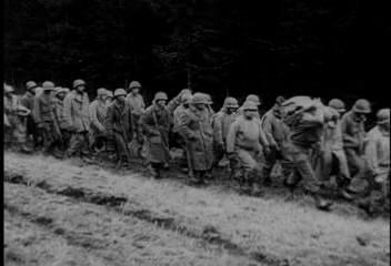 December 19, 1944:  Men from the 106th ID march east. (newsreel still)
