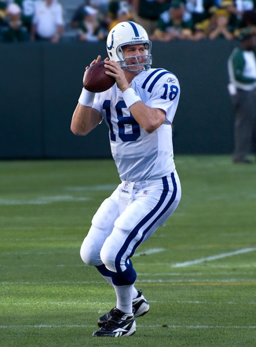 Peyton Manning's numbers dip a bit in December, but nothing compared to Tony Romo's.