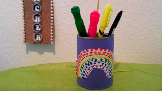A can with child's artwork and some new desk or art supplies will be a welcome gift to any teacher.