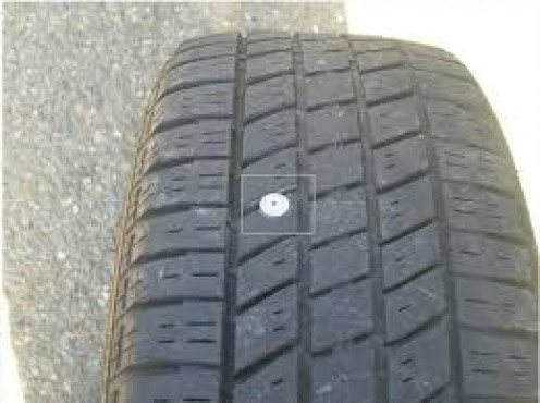 Small leaks such as a nail in the tire can be easily sealed up with fix a flat. Make sure and take the car to an air pump ASAP after using fix a flat first.