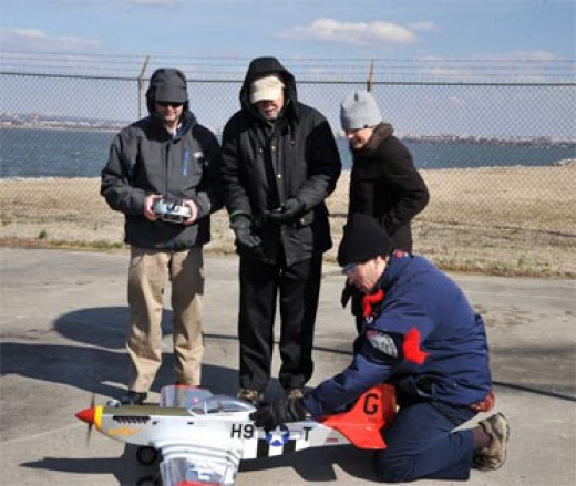 Flying a radio-controlled replica of the historic WWII P-51 Mustang red-tail aircraft.
