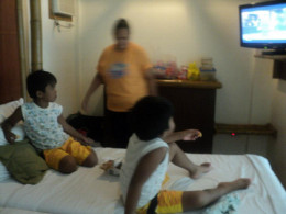 Kids watching TV inside Casa Montana