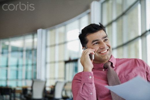 Pretending to call important clients to impress the other employees.