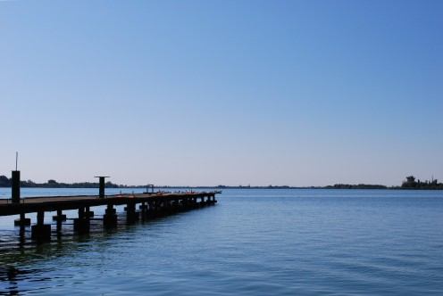 View of the Palic (Palics/Palić) lake, taken just west of the Ženski Štrand. Štrand's pier is in the view.