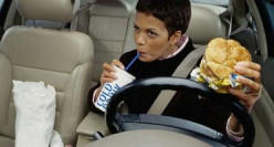 Should driving while eating and drinking beverages be outlawed?