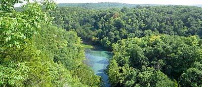 A creek runs through the Ozarks hills.