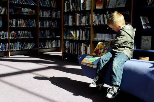 Boy reading alone
