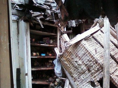 These photographs are from the rear of the house where the roof caved in on the kitchen area.