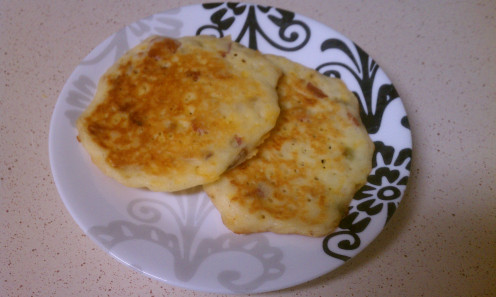 Gluten-free potato pancakes with cheese and bacon.