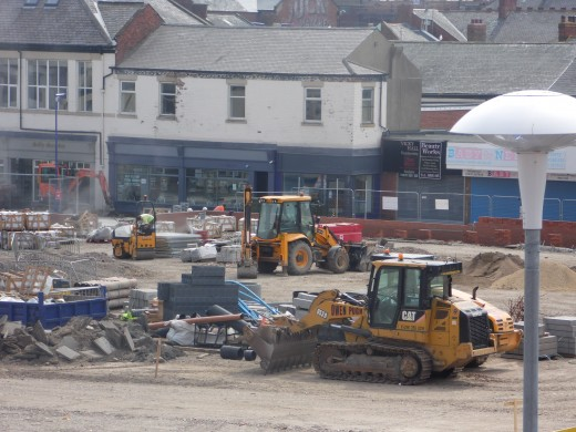The construction site in full flow: noise, dust and dirt, seven days a week