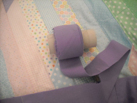 Don't have a lot of money for cool gadgets? Try winding your binding on a toilet paper roll.