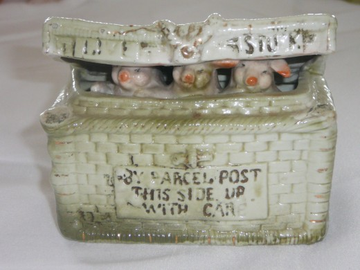 "3 little pigs in a basket. ""Parcel Post This Side Up With Care"". Featured in ""This little Piggy"" its '92 price was $120. 4"" x 3 1/4"" Paid $23. Rare"