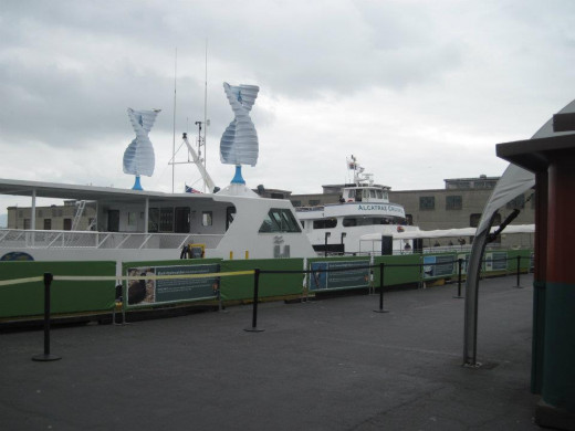 2 ferries from Pier 39 in San Francisco to Alcatraz Island; the nearer one is a new hybrid boat.