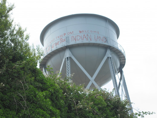 Water tower still features bold, bright red messages from when the Indians were occupying: 'Peace and Freedom Welcome', and then 'Land of the Free - Indian Land'. There's a heroic defiance that comes through loud and clear.