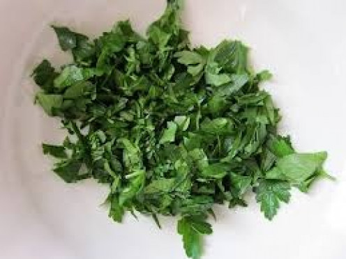 Chop fresh Parsley as fine as possible before using it in your Mushroom pasta dish.