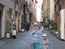 The children posing for a photo in the historic streets of Navona