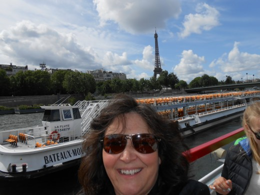 On a boat on the Seine River in Paris on a cruise stop...yep, earning money on Hub Pages!