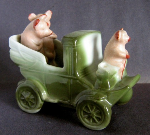 This motor coach complete with driver and 2 cutes pigs sold on ebay for $73. Rare.