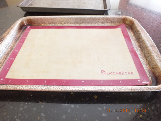 I have my cookie tray and sil-pat ready. The sil-pat is made of silicone so no oil is needed to coat the tray-- or add any additional calories.
