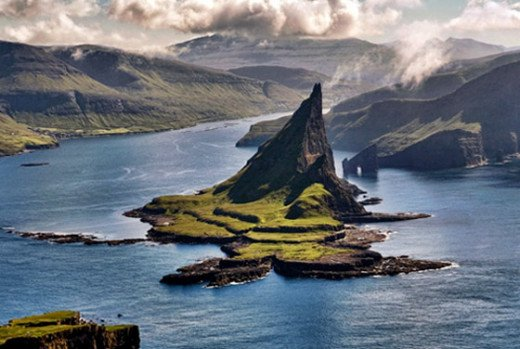 Like a world created by the Dark Elves... The Faeroe Islands - two main islands and many uninhabitable by man, crowded with sea-birds