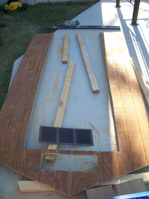 A rectangle was carefully measured, marked, and cut out for the front attic vent.