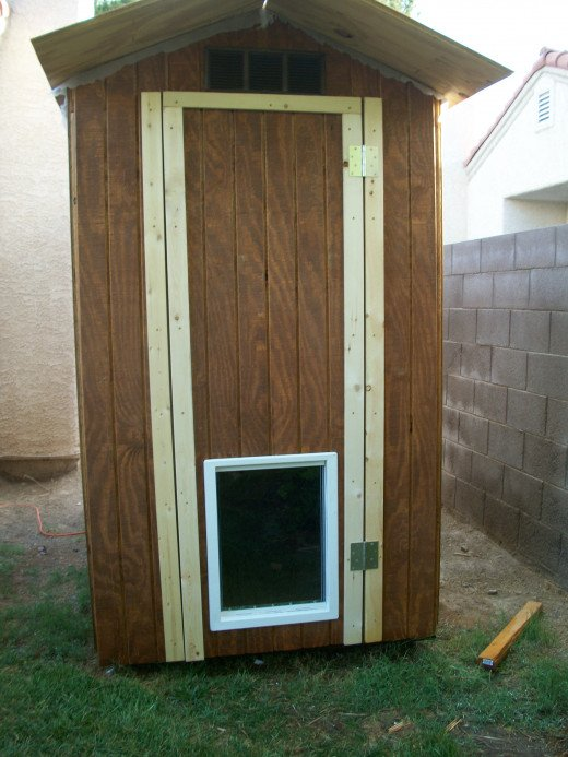 After front siding is installed and door assembly is complete, vertical trim was installed for mounting the hinges.