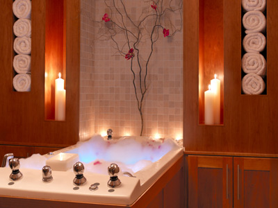 Create a relaxing atmosphere in your bathroom with candles and low lights.