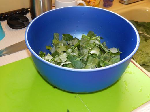 blue bowl of collard greens in strips