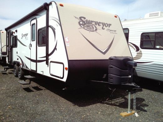 Travel trailers have a hitch that will attach to any capable vehicle so there's no need to buy a pickup if you don't already own one.