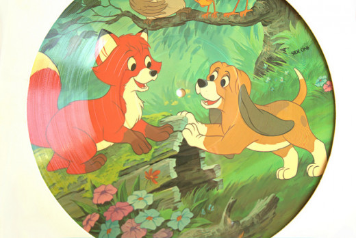 A picture of a record album with the Soundtrack for the Fox and the Hound animated movie.