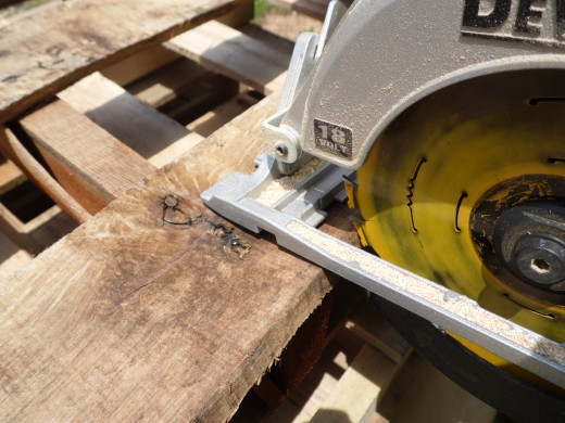 Cutting out sections of pallet planks.