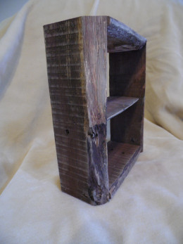Pallet wood shelf made with distressed planks.