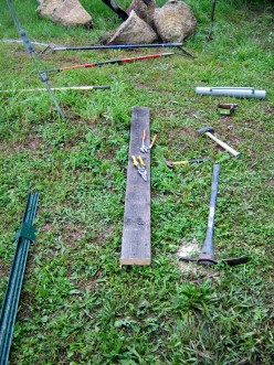 wood, pick, shovels, hammers, fence posts, etc...