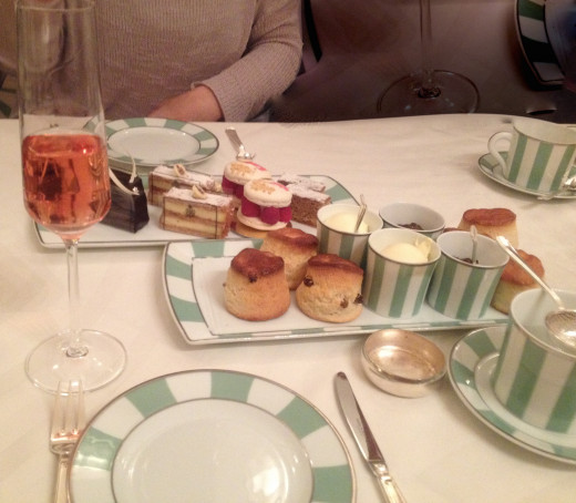 Scones, cream and jam plus pretty cakes for tea