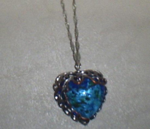This large blue pendant is made out of glass, but looks like a stone.