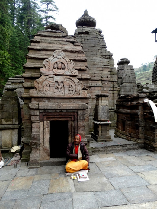 A temple with a priest sitting in front