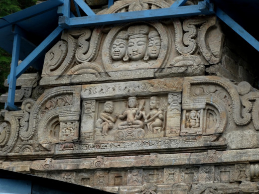 Stone carvings on the front facade of Mahamrityunjoy Shiva temple
