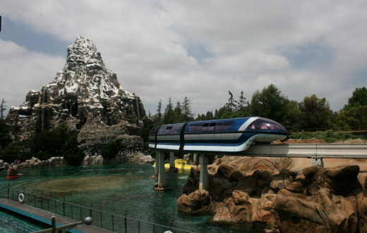 The monorail going through Disneyland and the Matterhorn