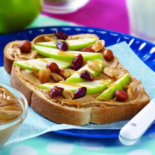 Face Peanut Butter Sandwich. The sandwich has peanut butter, apple ...