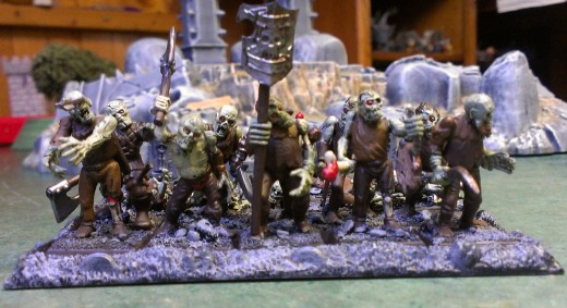 A horde of Zombies shambles into combat.